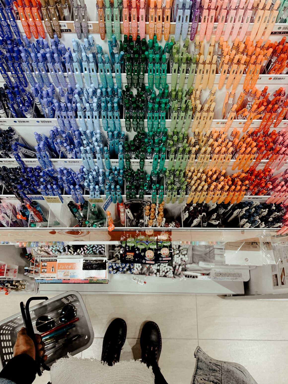 pen heaven. collection of pens. Japanese pens. Tokyo Pens. Standing in front of pens. Colorful pens. Tokyo Hands.