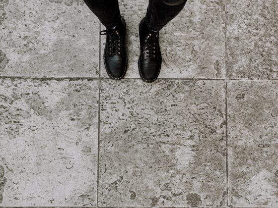 pictures of black doc martens from above in black outfit